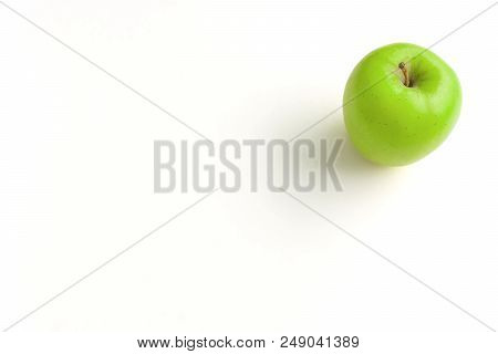 Close-up Of A Green Apple On A White Background.  View To A Fresh Apple On A Clean Background. Veget