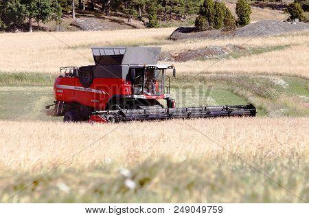 Morko, Sweden - July 10, 2018: Red Combine Harvester Massey Ferguson 9380 Delta Harvests Grain.