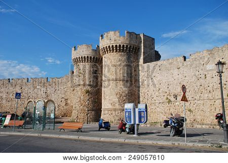 RHODES, GREECE - JUNE 12, 2018: Towers on the medieval fortified wall by Kolona harbour in Rhodes Old Town on the Greek island of Rhodes. The town is a UNESCO World Heritage Site.