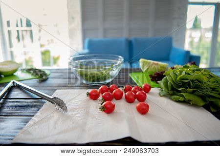 Cherry Tomatoes. Savory Little Nice Cherry Tomatoes Lying On The Napkin Drying Before Cutting For Sa
