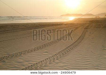Beach Sunset With Tire Tracks
