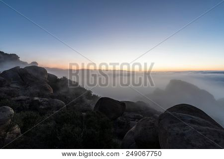 Dawn fog above the San Fernando Valley in Los Angeles California.  Shot from top of Rocky Peak Park near Simi Valley.