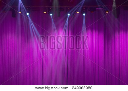 Spotlights Of Theater Stage With Purple Curtains