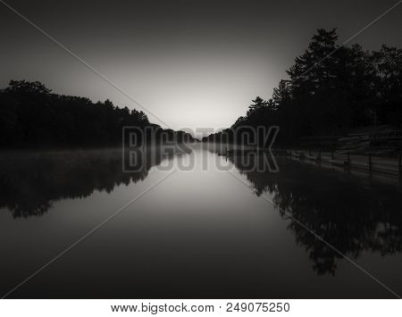 Early Morning Light Bring Out The Shape Of The River And Silhouetted Landscape. Black And White Fine