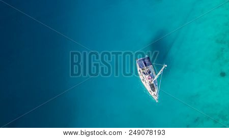 Sailing boat anchoring in Croatia bay, aerial view. Active life style, water transportation and marine sport.