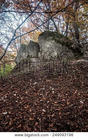 Autumn Mountain Landscape With Fallen Leaves, Colorful Trees And Rocks On Kecka Hill In Sulovske Ska