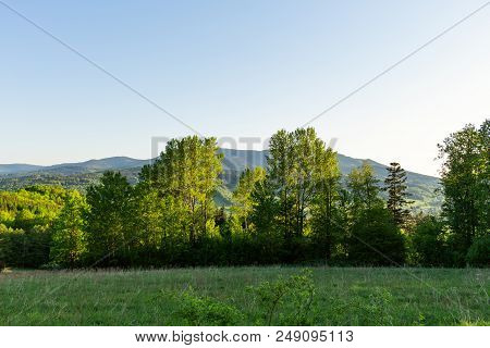 Majestic Landscape Of Mountains And Meadow. Cycling Mountain Road. Misty Mountain Road In High Mount