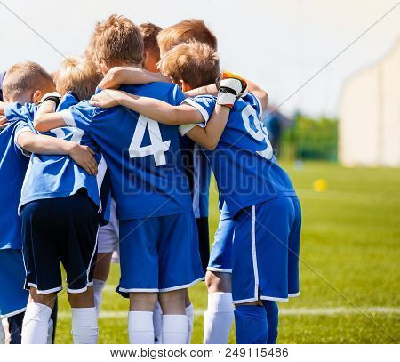 Boys Sports Team With Coach. Youth Soccer Team Huddle With Coach. Motivation Talk, Pep Talk Before T