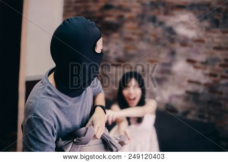 Anonymous Criminal Thief In Hidden Mask Trying To Snatch Purse Bag From Young Lady Fighting Each Oth
