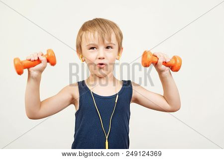 Funny Kid With Dumbbells, Doing Exercising, Listen Music With Headphones. Happy Little Boy Do Exerci