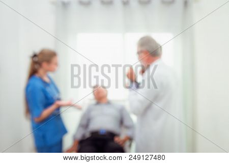 Abstract Motion Blurred Of Doctor Team Are Visit And Examining  Symptom Of Senior Patient In Examina