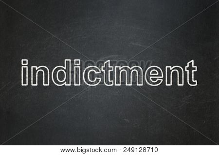 Law Concept: Text Indictment On Black Chalkboard Background
