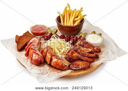 Big Barbeque Plate With Meat, French Fries, Garnish And Spicy Sauce, Top View, Close-up, Selective F