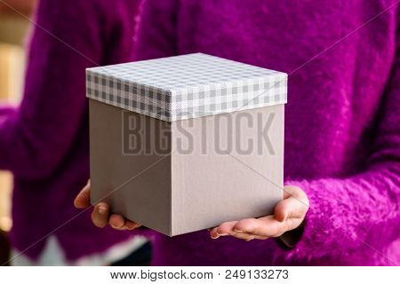 Unidentified Woman Holding A Gift. Concept Of Celebration Holidays And Surprise
