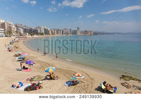 Calp, Spain-june 4th 2018: Beautiful Sunshine Drew Visitors And Holidaymakers To The La Fossa Levant