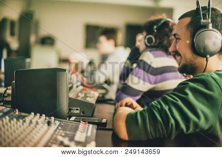 Behind The Scene. Film Crew In Studio For Film Montage. Analog And Digital Video Editing