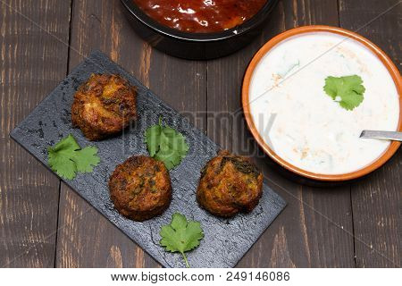 Asian Snacks  A Selection Of Asian Sacks With Mango Chutney And Raita
