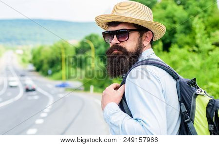 Travel alone. Hitchhiking means transportation gained asking strangers for ride in their car. Hitchhiker travel alone try stop transport to get to destination. Man at edge of highway wait transport. poster