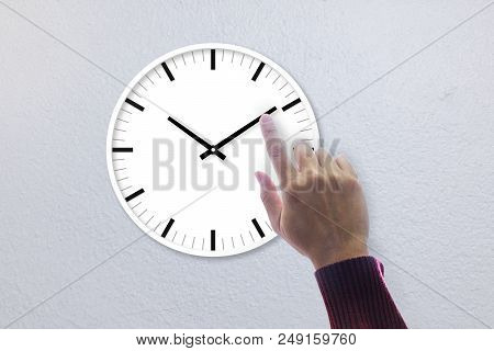 Right Hand Of A Man Touching A Hand Of A Clock In Concept Of Time Management And Under Control.
