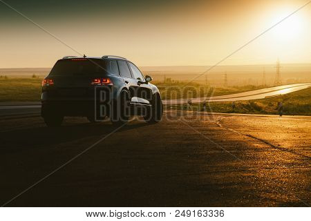 Saratov, Russia - June 07, 2018: Black Car Volkswagen Touareg Is Parked At Countryside Asphalt Road