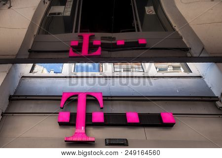 Szeged, Hungary - July 3, 2018: T Mobile Logo On Their Main Shop In Szeged. T-mobile, Is One Of The