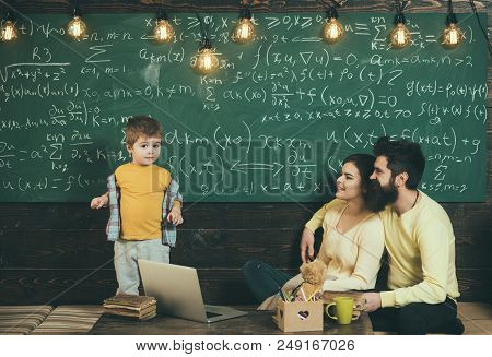 Home Schooling. Home Schooling Pupil At Chalkboard. Home Schooling Education With Parents. Family Ch
