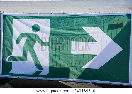 Transparent As A Sign For The Escape Route At An Event.