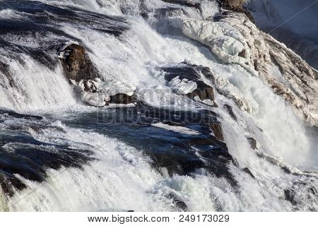 The Churning Water Of The White River Flowing Into The Golden Waterfall