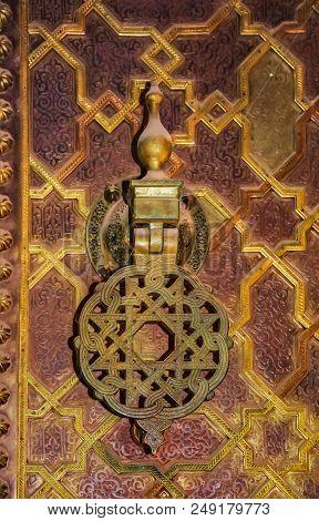 IIntricate metal knocker on an ornate gate in in Fez medina, Morocco poster