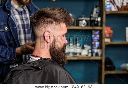 Hairstyle Service Concept. Hipster Bearded Client Got Hairstyle. Barber With Clipper Works On Hairst