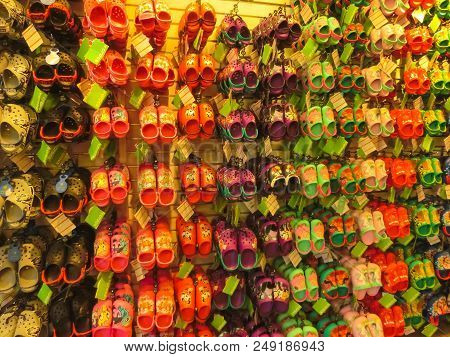 Tampa, Usa - May 10, 2018: Rack With Lots Of Pairs Of Childrens Soft Rubber Sandals Or Crocs In Vari