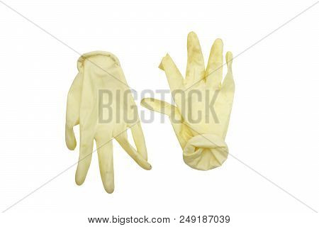 Disposable Surgical Gloves, Removed From Hands. Cuff Is Twisted, Rubber Damaged And Unsterile. Isola