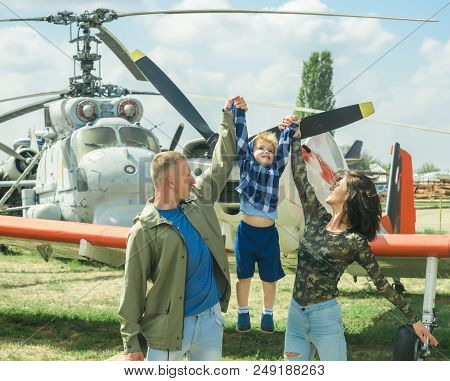 International Childrens Day. Child With Parents At Air Show On International Childrens Day. Son With