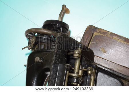 Antique Sewing Machine With Hand Crank. Bottom Mechanism, Hidden In The Desk. Clipping Path