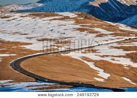Trail Ridge Road, the highest (12,183 feet) continuous highway in the USA in high alpine tundra with rocks and mountains at autumn. Rocky Mountain National Park in Colorado, USA.