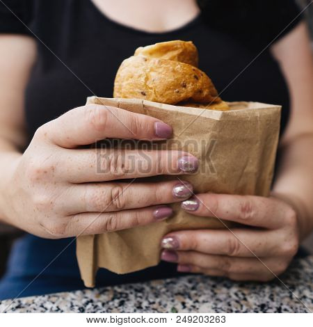 Snack On The Go, Junk Food, Coffee Break Concept. Young Woman Holding Fast Food Croissant, High-calo
