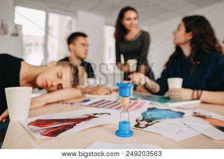 Time Management, Deadline, Sleep Deprivation, Daily Routine. Young Worker Sleeping At Work During Bu