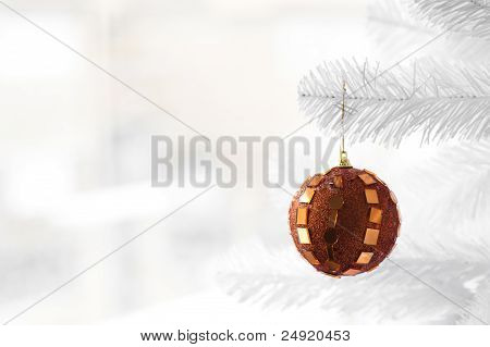 Orange bauble on Christmas Tree