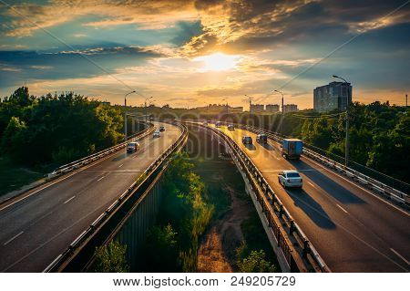 City Traffic On Asphalt Road Or Highway Route At Sunset Time, Lot Of Cars Drive With Fast Speed, Urb