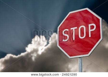 stop road sign on the blue sky background poster