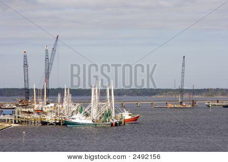 Construction Cranes And Shrimp Boats