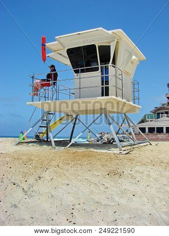 Encinita, California / United States - June 30 2012: A Lifeguard Sitting In His Lifeguard Tower In E