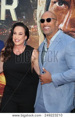NEW YORK - JUN 10: Actor Dwayne Johnson (R) and  executive producer Dany Garcia attend the premiere of