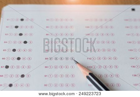Black Pencil And Word Tests On Paper Computer Sheet. Standardized Test Form With Answers Bubble. Mul