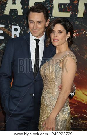 NEW YORK - JUN 10: Actress Neve Campbell (R) and JJ Field attend the premiere of