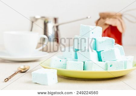 A Plate With A Few Homemade Blue Marshmallow Cubes Close-up