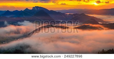Spectacular, Fairytale Sunset Over The Mountains, Floating Mist Highlighted By The Setting Sun, Pien