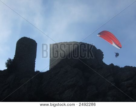 Para Glider Over Mountain Castle In Misty Rays