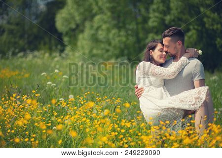 Couple Walking In The Yellow Meadow, Man Keeping A Woman In His Arms, Summer, Nature, Love, Toned Ph
