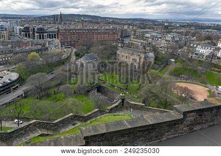 Edinburgh, Scotland - April 2018: Cityscape Of Old Town Edinburgh From Princess Street Gardens Towar